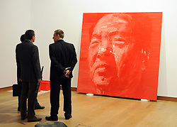 ©London News pictures. 08.02.2011. A group of men in suits stand in front of a portrait of Moa by Yan Pei-Ming entitled Grand Timonier. A preview, today (Fri) of Christie's Auction House Post-War and Contemporary Art Evening Auction. The sale is expected to make a combined total of £46,246,000 to £66,447,000 when it is sold on 16th Feb 2011.. Picture Credit should read Stephen Simpson/LNP