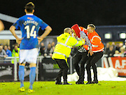 A man who invaded the pitch is caught by security guards during the The FA Cup third round match between Eastleigh and Bolton Wanderers at Silverlake Stadium, Ten Acres, Eastleigh, United Kingdom on 9 January 2016. Photo by Graham Hunt.