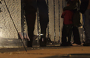 """A northern Michigan family pays a night time visit to the Traveling Vietnam Veterans Memorial, the """"Traveling Wall"""",  during its visit to Petoskey, Michigan."""