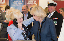 Annual ICAP Charity Day.<br /> In the image: HRH The Duchess of Cornwall speaking to dealers closing some deals with Barbara Windsor.<br /> HRH The Duchess of Cornwall attends the Annual ICAP Charity Day in the City, London, United Kingdom. Tuesday, 3rd December 2013. Picture by  i-Images