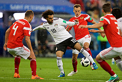 SAINT PETERSBURG, RUSSIA - Tuesday, June 19, 2018: Egypt's Mohamed Salah and Russia's Denis Cheryshev during the FIFA World Cup Russia 2018 Group A match between Russia and Egypt at the Saint Petersburg Stadium. (Pic by David Rawcliffe/Propaganda)