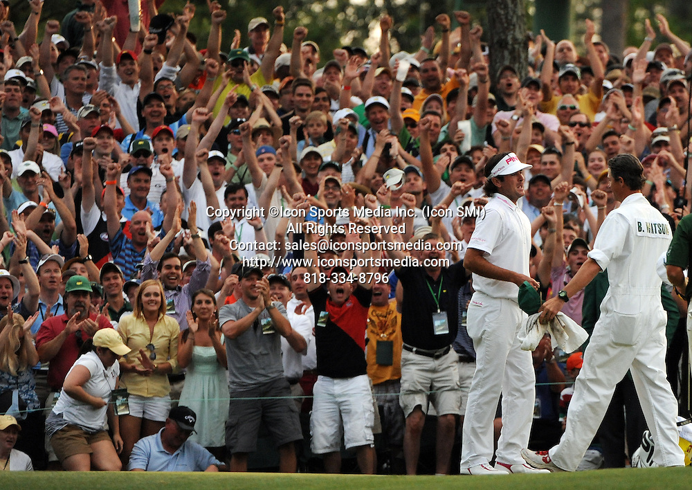 April 8, 2012 - Augusta, Georgia, U.S. - Bubba Watson, second from right, celebrates with his caddie Ted Scott after winning the 2012 Masters Tournament at Augusta National Golf Club on Sunday April 8, 2012, in Augusta, Ga.