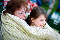 Rheana Pollos and her grandmother, Karen Pollos, relax under a blanket before the start of the festivities on Sunday, July 4, 2010 at her aunt Emily's home in Rathdrum, Idaho.