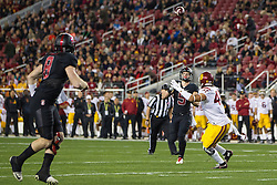 SANTA CLARA, CA - DECEMBER 05:  Running back Christian McCaffrey #5 of the Stanford Cardinal throws a pass for a touchdown to quarterback Kevin Hogan #8 past linebacker Scott Felix #47 of the USC Trojans during the second quarter of the Pac-12 Championship game at Levi's Stadium on December 5, 2015 in Santa Clara, California. (Photo by Jason O. Watson/Getty Images) *** Local Caption *** Christian McCaffrey; Kevin Hogan; Scott Felix