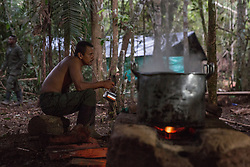 El Diamante, Meta, Colombia - 16.09.2016        <br /> <br /> Kitchen area of the guerilla camp during the 10th conference of the marxist FARC-EP in El Diamante, a Guerilla controlled area in the Colombian district Meta. Few days ahead of the peace contract passing after 52 years of war with the Colombian Governement wants the FARC decide on the 7-days long conferce their transformation into a unarmed political organization. <br /> <br /> Kueche des Guerilla-Camps zur zehnten Konferenz der marxistischen FARC-EP in El Diamante, einem von der Guerilla kontrollierten Gebiet im kolumbianischen Region Meta. Wenige Tage vor der geplanten Verabschiedung eines Friedensvertrags nach 52 Jahren Krieg mit der kolumbianischen Regierung will die FARC auf ihrer sieben taegigen Konferenz die Umwandlung in eine unbewaffneten politischen Organisation beschlieflen. <br />  <br /> Photo: Bjoern Kietzmann