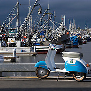 1964 Vespa GL on dock with fishing boats at Fisherman's Terminal, Salmon Bay, Seattle, Washington