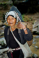 Burma/Myanmar. Akha woman with a basket.