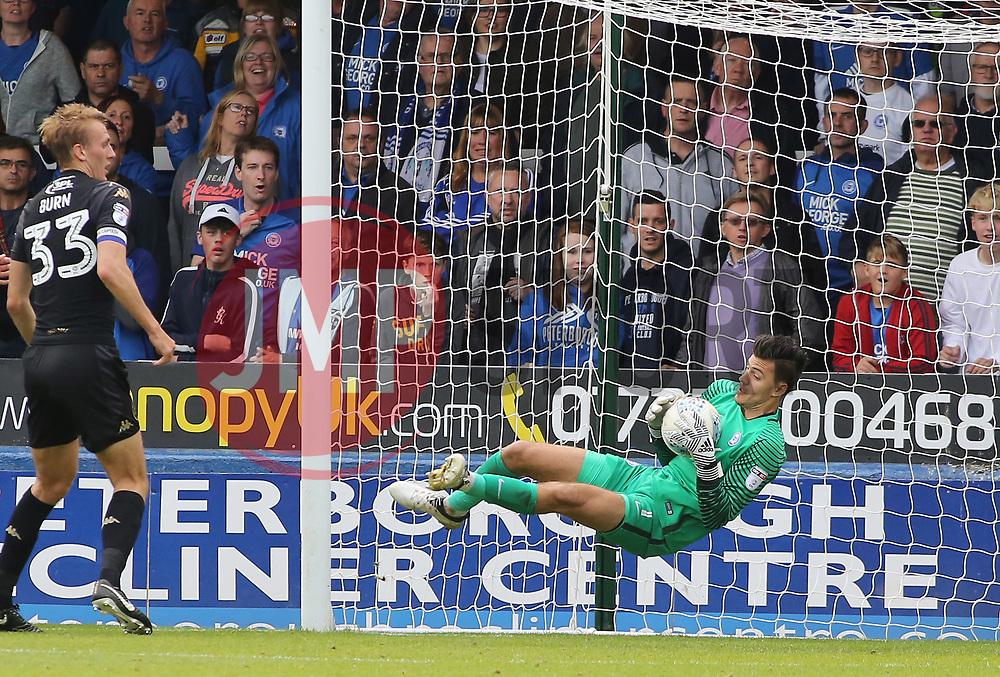 Jonathan Bond of Peterborough United makes a diving save - Mandatory by-line: Joe Dent/JMP - 23/09/2017 - FOOTBALL - ABAX Stadium - Peterborough, England - Peterborough United v Wigan Athletic - Sky Bet League One