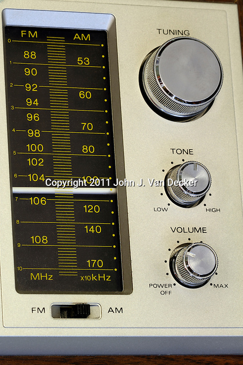 Closeup of an old analog radio's controls.