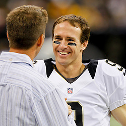 October 7, 2012; New Orleans, LA, USA; Joe Unitas son of former NFL quarterback Johnny  Unitas greets New Orleans Saints quarterback Drew Brees (9) before a game against the San Diego Chargers  at the Mercedes-Benz Superdome. Joe Unitas is attending to witness Brees attempt to break his father's consecutive games throwing a touchdown record streak. Mandatory Credit: Derick E. Hingle-US PRESSWIRE