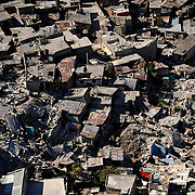 100128-N-5345W-268.PORT-AU-PRINCE, Haiti (Jan. 28, 2010) .A decimated neighborhood lies in ruins in the Haiti capital of Port-au-Prince following the devastating magnitude 7.0 earthquake that struck the region Jan. 12. The multi-purpose amphibious assault ship USS Bataan (LHD 5) and the amphibious dock landing ships USS Fort McHenry (LSD 43), USS Gunston Hall (LSD 44) and USS Carter Hall (LSD 50) are participating in Operation Unified Response as the Bataan Amphibious Relief Mission by providing military support capabilities to civil authorities to help stabilize and improve the situation in Haiti. (U.S. Navy photo by Mass Communication Specialist 2nd Class Kristopher Wilson/RELEASED)