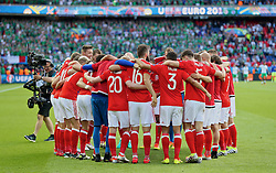 PARIS, FRANCE - Saturday, June 25, 2016: Wales' players celebrate after the 1-0 victory over Northern Ireland sealing progression to the Quarter-Final during the Round of 16 UEFA Euro 2016 Championship match at the Parc des Princes. (Pic by David Rawcliffe/Propaganda)
