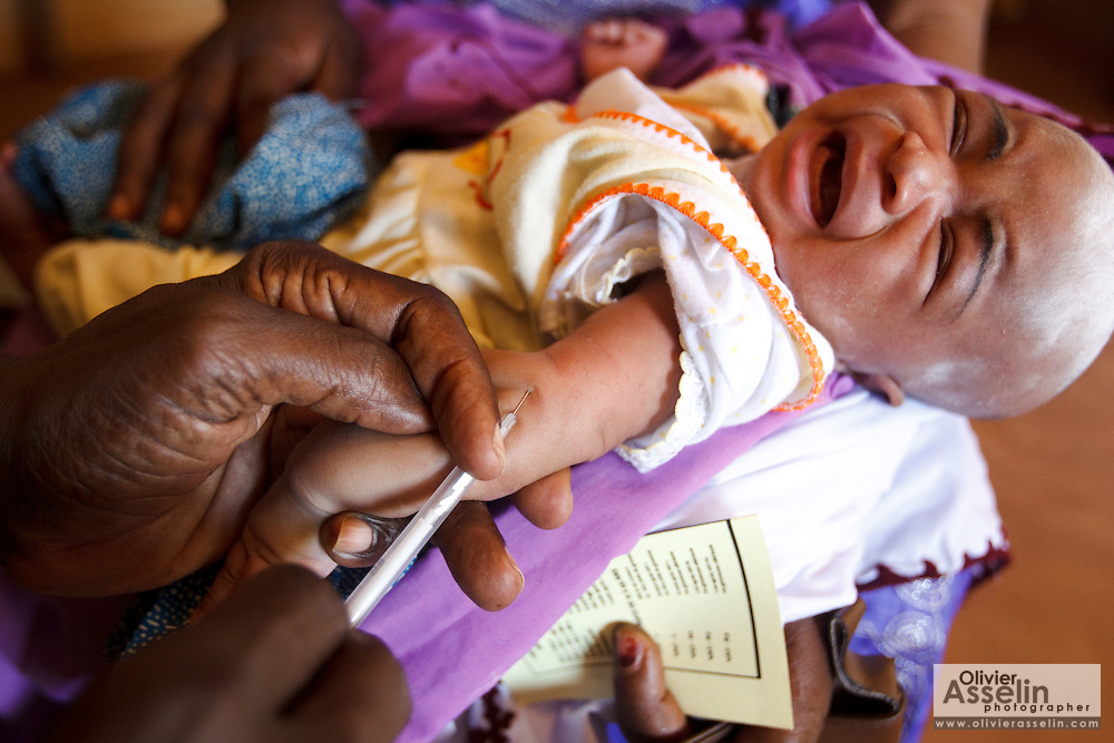 Vaccination team leader N'Faly Samaka vaccinates a child against measles at the Kita reference health center in the town of Kita, Mali on Monday August 30, 2010.