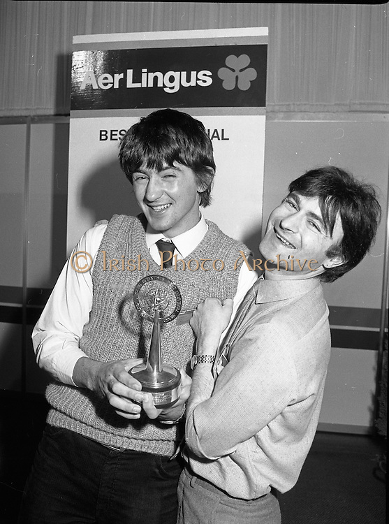07/01/1983.01/07/1983.7th January 1983.The Aer Lingus Young Scientist Exhibition at the RDS, Dublin...Picture shows the winner Timothy Hickey from Colaiste De La Salle, Co. Cork being congratulated by his teacher Kevin Corcoran. ..