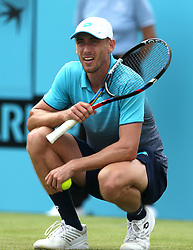 Australia's John Millman reacts against a decision during day two of the Fever-Tree Championship at the Queens Club, London.
