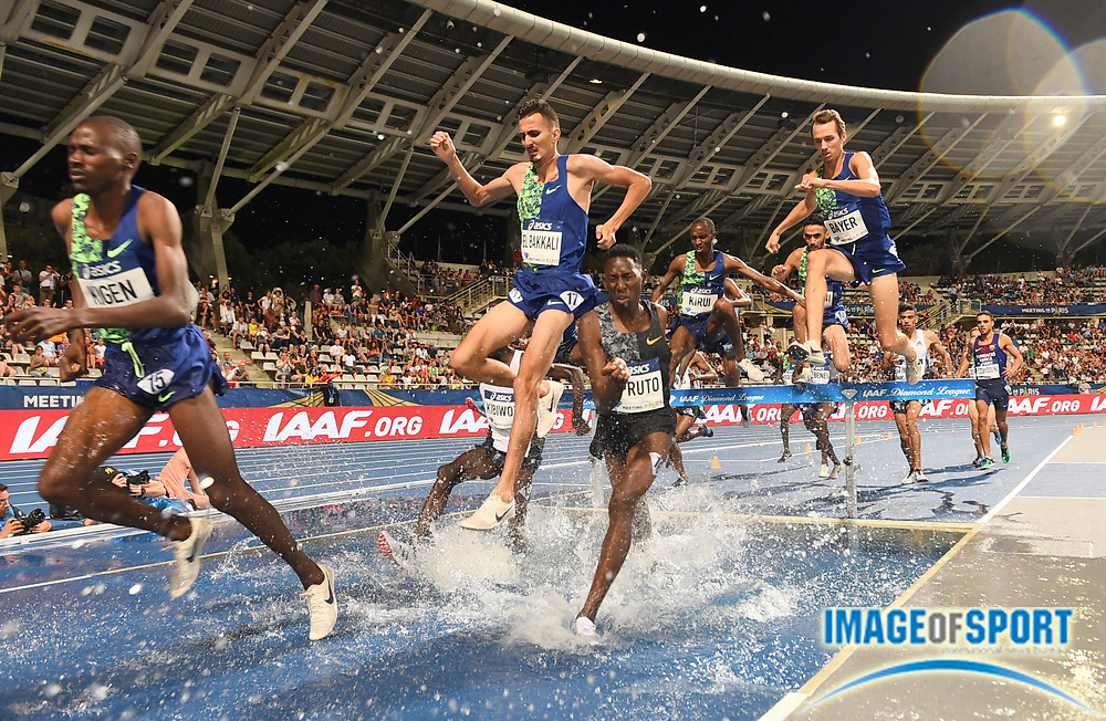 Soufiane El Bakkali (MAR) and Conseslus Kipruto (KEN) race over the water jump in the steeplechase during the Meeting de Paris, Saturday, Aug. 24, 2019, in Paris. (Jiro Mochizuki/Image of Sport via AP)