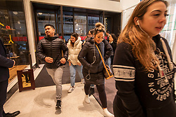 © Licensed to London News Pictures. 26/12/2019. Boxing Day bargain hunters brave the cold and the rain in Oxford Street for a chance to get large discounts on designer items at Selfridges this morning . Alex Lentati/LNP