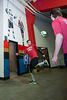 KELOWNA, CANADA -FEBRUARY 25: Tyler Mrkonjic #10 of the Prince George Cougars warms up with teammates at the Kelowna Rockets below the mural of Kelowna Rockets' alumni and current NHL players, 2014 Olympic Men's Hockey and 2009 World Junior Championship gold medalist, Jamie Benn and 2009 World Junior Championship gold medalist, Tyler Myers on February 25, 2014 at Prospera Place in Kelowna, British Columbia, Canada.   (Photo by Marissa Baecker/Getty Images)  *** Local Caption *** Tyler Mrkonic; Jamie Benn, Tyler Myers;