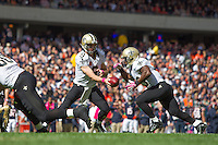 06 October 2013: Quarterback (9) Drew Brees of the New Orleans Saints ands the ball off to (23) Pierre Thomas against the Chicago Bears during the XX half of the Saints 26-18 victory over the Bears in an NFL Game at Soldier Field in Chicago, IL.