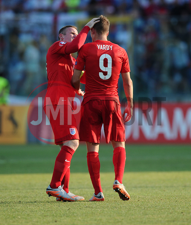 Wayne Rooney of England (Manchester United) checks on the welfare of Jamie Vardy of England (Leicester City)  - Mandatory byline: Joe Meredith/JMP - 07966386802 - 05/09/2015 - FOOTBALL- INTERNATIONAL - San Marino Stadium - Serravalle - San Marino v England - UEFA EURO Qualifers Group Stage