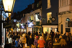 © Licensed to London News Pictures. 3/12/2016. Lincoln, UK. Thousands of people descended upon Lincoln over the weekend to start their Christmas shopping and visit the annual Christmas market. With over 200 stalls surrounding the Cathedral and Castle in the uphill area a one way system to control visitors had to be put in place due to the huge crowds thronging the City Centre. Pictures shows Steep Hill around the Uphill area. Photo credit: Dave Warren/LNP