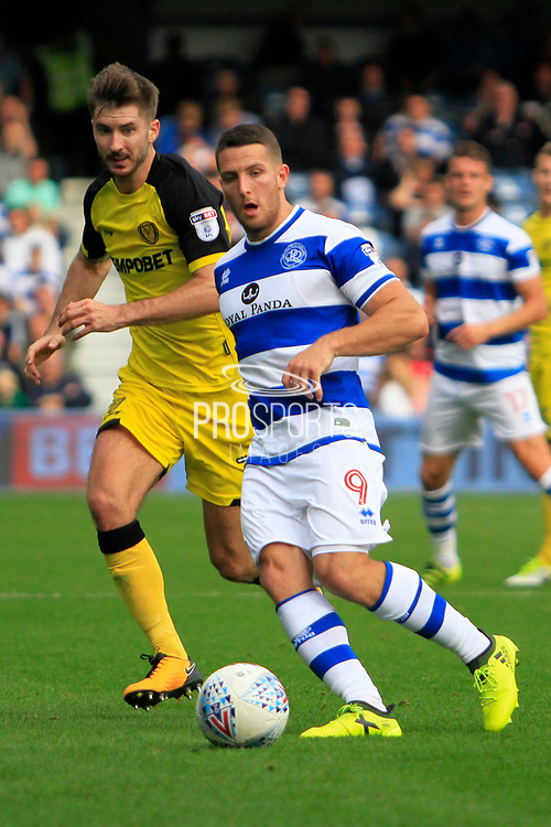 Queens Park Rangers striker Conor Washington (9) controls the ball away from Burton Albion midfielder Luke Murphy (7) during the EFL Sky Bet Championship match between Queens Park Rangers and Burton Albion at the Loftus Road Stadium, London, England on 23 September 2017. Photo by Richard Holmes.