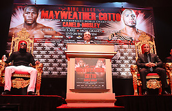 Feb 28; New York, NY, USA; Richard Schaefer, of Golden Boy Promotions, speaks during the press conference announcing fight between Floyd Mayweather (left) and Miguel Cotto (right). The two will meet May 5, 2012 at the MGM Grand Garden Arena in Las Vegas, NV.