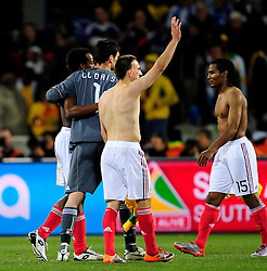 A dejected Florent Malouda, Sydney Gouvou, Hugo Lloris and Frank Ribery after losing 2-1 in the 2010 World Cup Soccer match between South Africa and France played at the Freestate Stadium in Bloemfontein South Africa on 22 June 2010.
