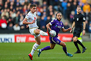 Portsmouth midfielder Marcus Harness (19) tussles with Milton Keynes Dons midfielder Jordan Houghton (24) during the EFL Sky Bet League 1 match between Milton Keynes Dons and Portsmouth at Stadium MK, Milton Keynes, England on 29 December 2019.
