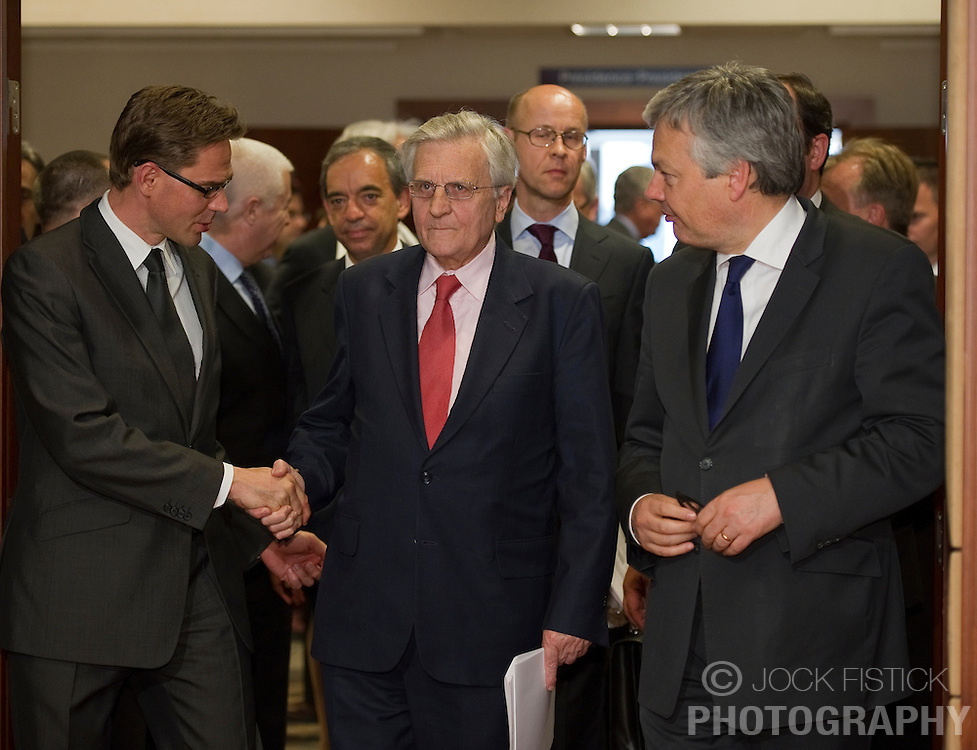 Jean-Claude Trichet, president of the European Central Bank, center is greeted by Jyrki Katainen, Finland's finance minister, left, and Didier Reynders, Belgium's finance minister, right, as they arrive for the Eurogroup meeting in Brussels on Monday May 17, 2010. (Photo © Jock Fistick)