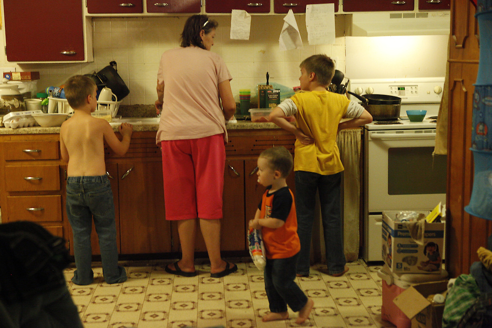 Austin and Alex help Debbie make dinner. She says she cooks for the family almost every night.