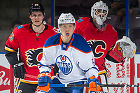 PENTICTON, CANADA - SEPTEMBER 8: Ostap Safin #59 of Edmonton Oilers looks for the pass in front of Tyler Parsons #82 and Josh Healey #85 of Calgary Flames during first period on September 8, 2017 at the South Okanagan Event Centre in Penticton, British Columbia, Canada.  (Photo by Marissa Baecker/Shoot the Breeze)  *** Local Caption ***