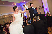 Arielle and Dance celebrate their Jewish wedding with family and friends at Oceano Hotel & Spa in Half Moon Bay, California, on March 1, 2014. (Stan Olszewski/SOSKIphoto for Matthias Photography)