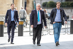 © Licensed to London News Pictures. 23/04/2017. London, UK. Chairman of the Conservative Party Patrick McLoughlin (centre) arrives at Broadcasting House before appearing on Sunday Politics. McLoughlin is reported to have said that Jeremy Corbyn, Leader of the Labour Party, 'is not suitable to become prime minister of this country' in the upcoming 8 June General Election. Photo credit: Rob Pinney/LNP