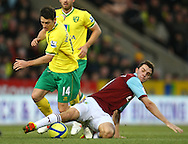 Picture by Paul Chesterton/Focus Images Ltd.  07904 640267.07/01/12.Wes Hoolahan of Norwich and Jay Rodriguez of Burnley in action during the FA Cup third round match at Carrow Road Stadium, Norwich.