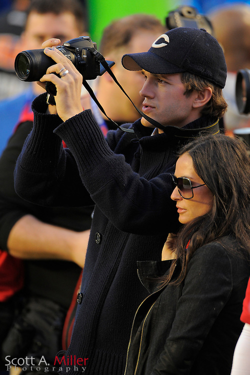 Miami, FL, USA; Feb 7, 2010; Actor Ashton Kutcher, left looks though his Nikon camera with his wife actress Demi Moore at his side  prior to Super Bowl XLIV at Sun Life Stadium. ....©2010 Scott A. Miller