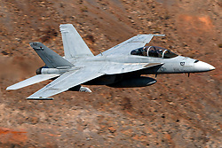 United States Navy Boeing F/A-18F Super Hornet (NJ 107) from the VFA-122 Flying Eagles squadron, Naval Air Station Lemoore, flies low level on the Jedi Transition through Star Wars Canyon / Rainbow Canyon, Death Valley National Park, Panamint Springs, California, United States of America