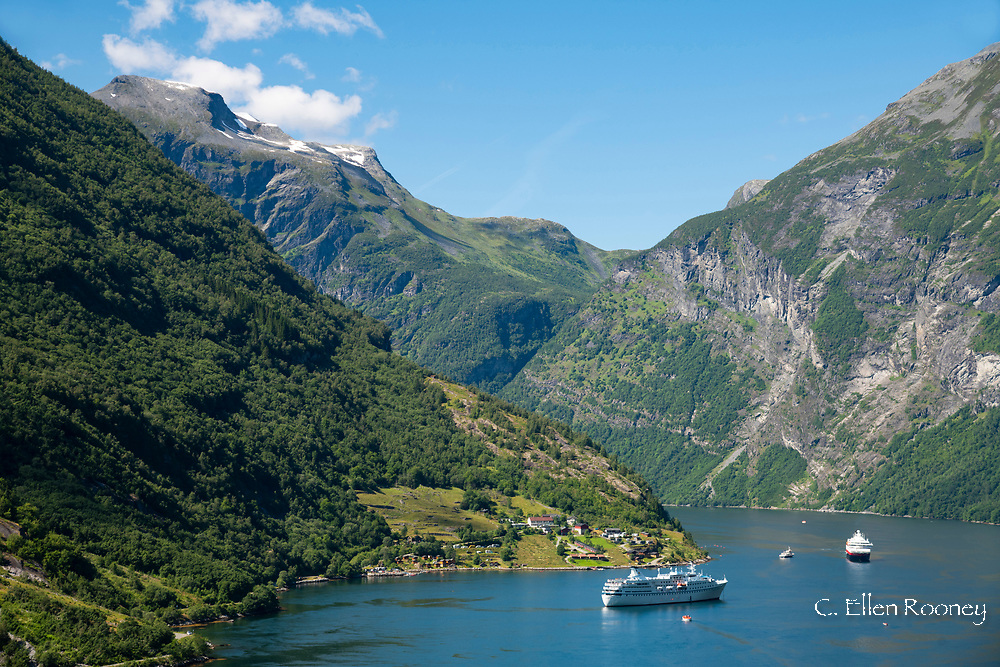 Cruiseships surrounded by tall mountains on Geiranger Fjord, Geiranger, Vestlandet, Norway