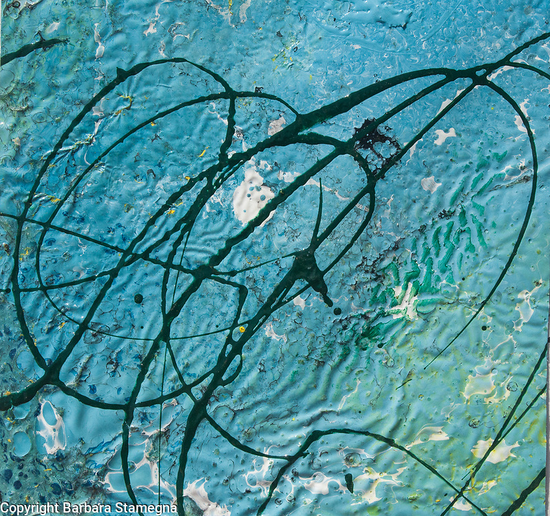 abstract sketch on blue rippled background with dark twisted lines