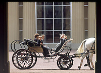 Prince William and Prince Harry with their royal cousins riding in one of the Queen's carriages at Buckingham Palace, London at the end of the Trooping of the Colours. 1988. Photograph by Jayne Fincher