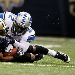 January 7, 2012; New Orleans, LA, USA; Detroit Lions cornerback Aaron Berry (32) tackles New Orleans Saints running back Darren Sproles (43) during the 2011 NFC wild card playoff game at the Mercedes-Benz Superdome. Mandatory Credit: Derick E. Hingle-US PRESSWIRE