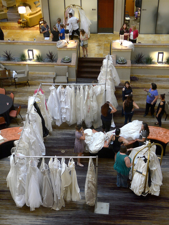 gbs072717e/ASEC -- Bride's to be look through wedding dresses in the Atrium of the Albuquerque Marriott Pyramid North. The dresses were donated to the bridal dress drive for women left out in the cold by the closing of Alfred Angelo bridal shop on Thursday, July 27, 2017. (Greg Sorber/Albuquerque Journal)