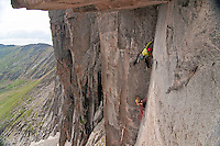 Jay Brown (on lead) sinks his tips into the bullet hard granite on the 3rd pitch of Undertow 5.12-, Black Wall, Mt Evans.