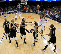 Surrounded by the entire Wake Forest team, Virginia's Monica Wright (22) gets a shot off for two of her 15 points.  The Cavaliers defeated the Demon Deacon 77-71 on January 11, 2007 for their first ACC win in the John Paul Jones Arena in Charlottesville, VA.<br />