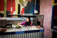 TUNIS, TUNISIA - 26 JULY 2013: A waitress prepares fresh glasses of water and lemonade at L'Etoile du Nord, a funky post-modern cafe in Tunis, Tunisia, on July 26th 2013.<br /> <br /> Tunisia, birthplace of the Arab Spring revolutionary movement, was plunged into a new political crisis on Thursday when assassins shot Mohamed Brahmi, 58, leader of the Arab nationalist People's Party, an opposition party leader outside his home in a hail of gunfire.