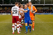 AFC Wimbledon defender Barry Fuller (2) shakes the hand of Bradford City defender Anthony McMahon (29)  during the EFL Sky Bet League 1 match between AFC Wimbledon and Bradford City at the Cherry Red Records Stadium, Kingston, England on 23 December 2017. Photo by Simon Davies.