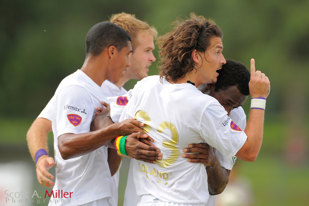 Orlando City forward Drew Helm (23) celebrates a goal with his teammates during their 4-2 over the Austin Aztex  in the PDL Southern Conference Championships final at Trinity Catholic High Schooll on July 22, 2012 in Ocala, Florida. ..©2012 Scott A. Miller