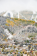 Light dusting of snow over fall colors in the town of Park City, Utah
