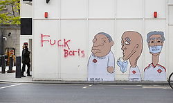 © Licensed to London News Pictures. 07/06/2020. London, UK. The words 'Fuck Boris' have been sprayed next to a mural in support of London Transport workers during yesterday's Black Lives Matter protest march . New quarantine rules on passengers entering the United Kingsom come into force tomorrow. People entering the country will have to quarantine for two weeks. Photo credit: Peter Macdiarmid/LNP