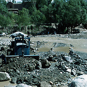 21 May 1976<br /> Close-up of bulldozer pushing gravel. Orchard of north section in background.